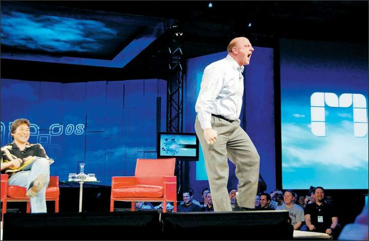 """Microsoft CEO Steve Ballmer, with Guy Kawasaki behind him, yells """"Web developers, Web developers!"""" at the urging of the Mix08 Internet audience Thursday. (LONG ZHENG / ISTARTEDSOMETHING.COM)"""