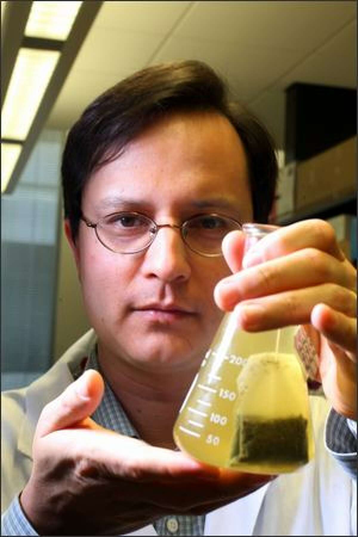 Dr. Paul Nghiem, a skin cancer expert at the UW and Fred Hutchinson Cancer Research Center, has been studying how caffeine protects skin cells and mice from developing cancer.