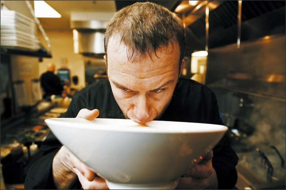Boom Noodle executive chef Jonathan Hunt tastes some fresh broth in his Capitol Hill kitchen. He toured Japan to absorb the flavors and styles of the food. Photo: Mike Urban/Seattle Post-Intelligencer