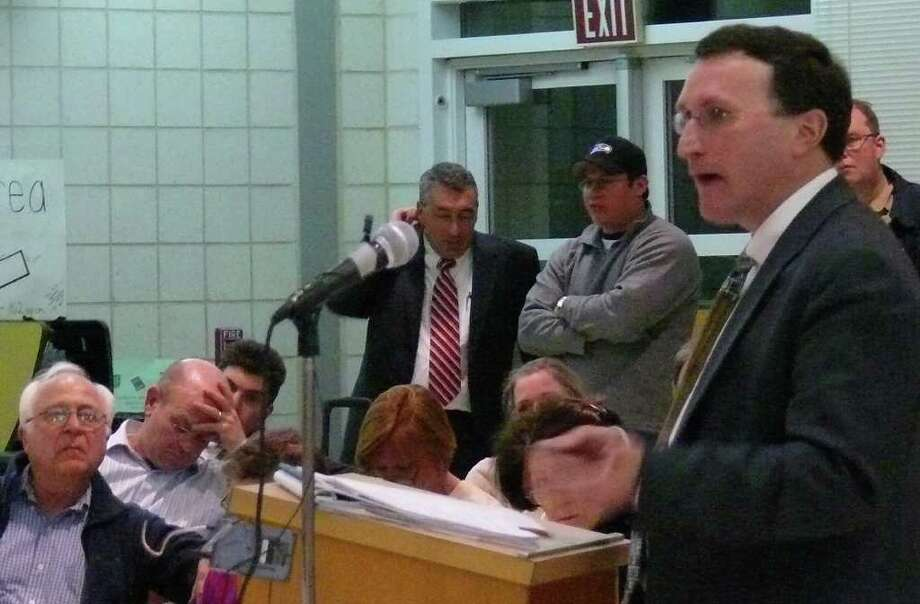 Keith Ainsworth, the lawyer for the intervenors opposed to a girls softball field on Hoydens Lane, addresses the Town Plan and Zoning Commission hearing Tuesday night in McKinley School. Photo: Genevieve Reilly / Fairfield Citizen