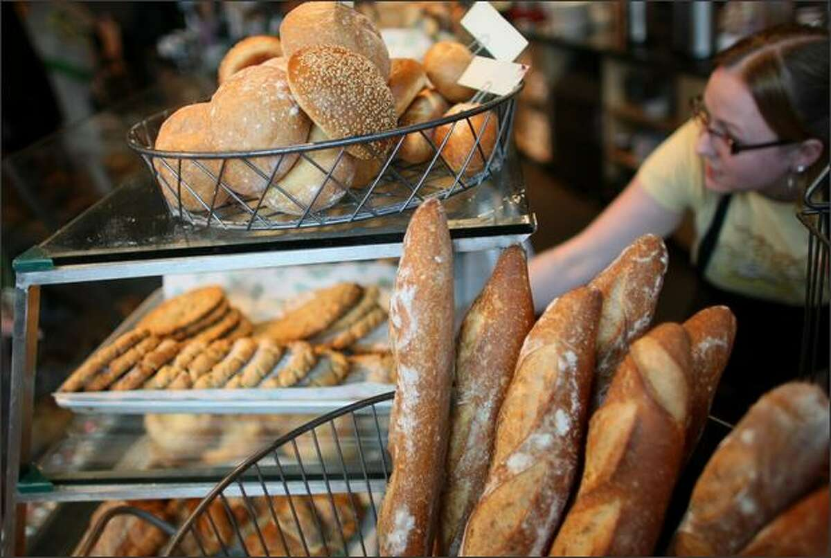 Bread products, such as these at Grand Central Bakery, aren't the only food items affected by the high cost of wheat. Since the grain also is fed to livestock, beef and poultry prices likely will rise.