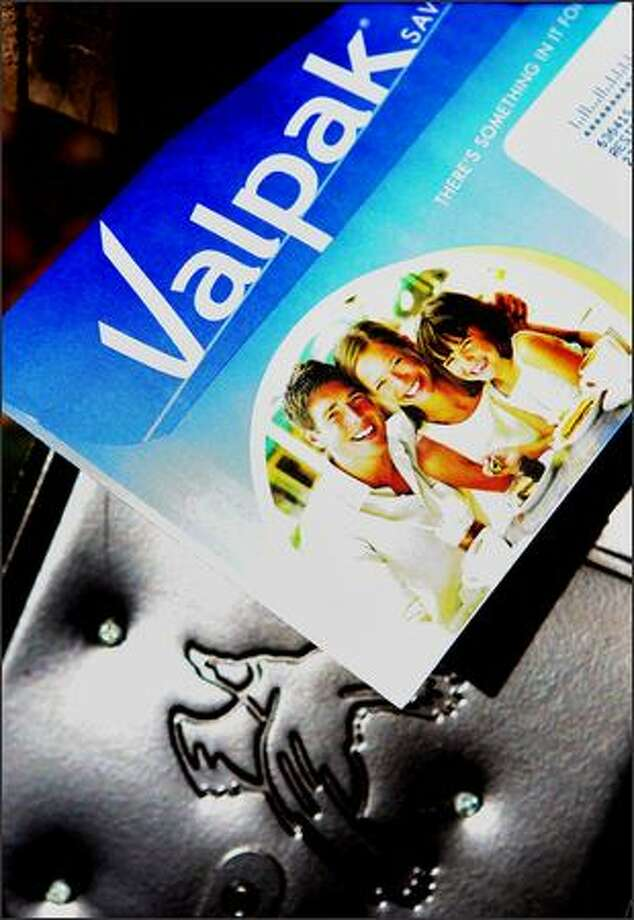 Valpak's well-known envelopes stuffed with coupons are mailed to 45 million homes a month. Photo: / Associated Press