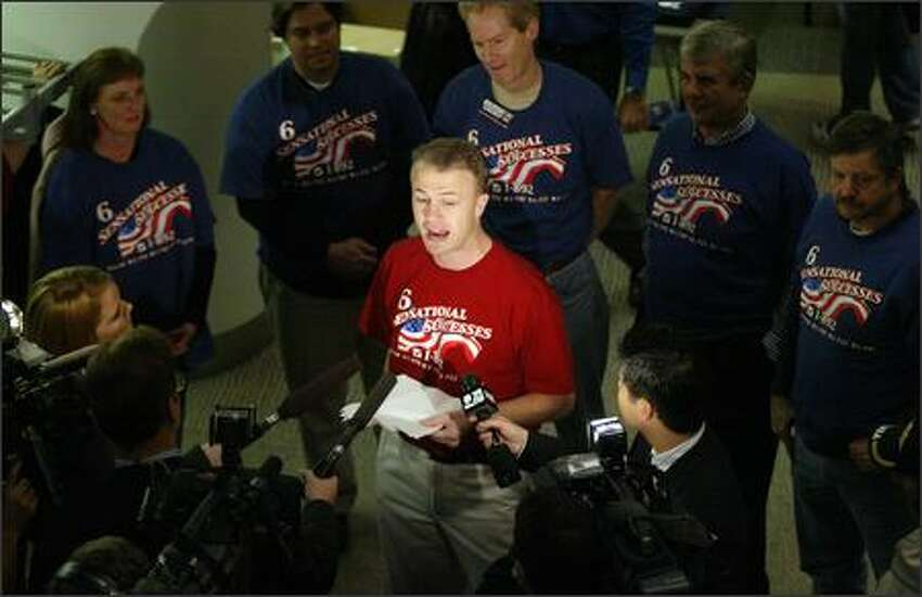 Tim Eyman addresses the media during the Republican party on Tuesday at the Meydenbauer Center in Bellevue.