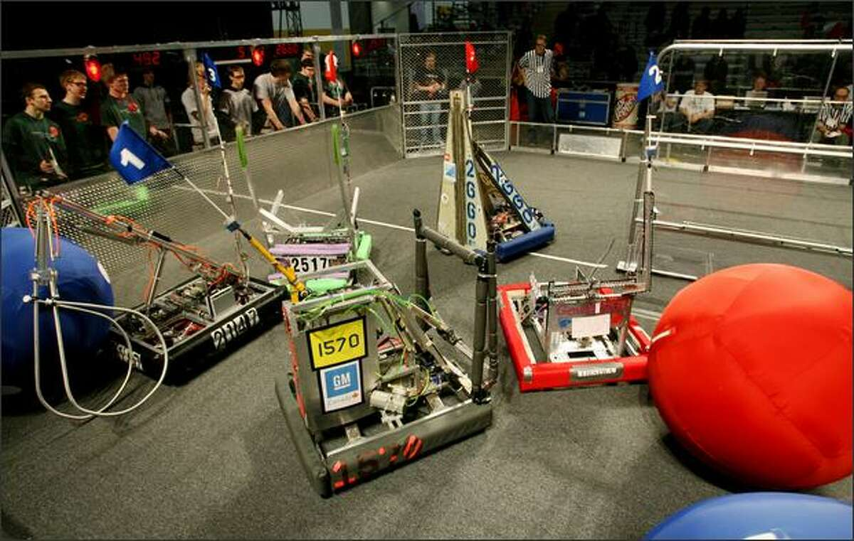 Robotics teams earned points by using their machines to knock balls from a shelf or to pick the balls up and move them around the field.