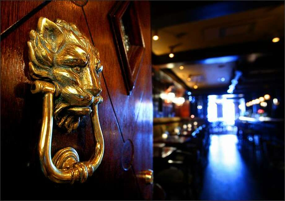 This lion knocker hangs on the door of the hotel's Hunt Club. Photo: Scott Eklund/Seattle Post-Intelligencer