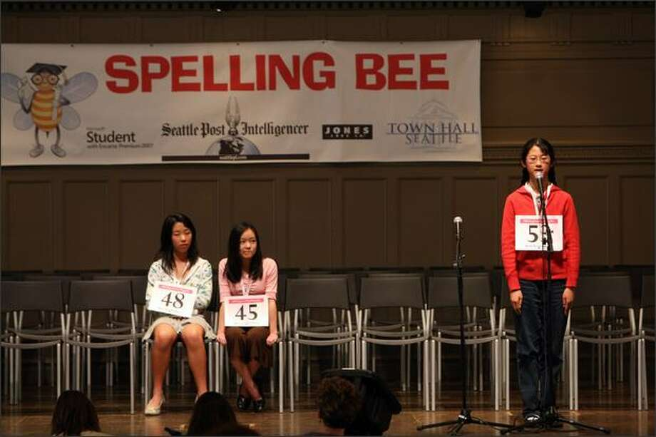 Elizabeth Zhang, No. 53, is asked to spell a word Sunday while No. 48 Julia Tombari and No. 45 Amy Tamura wait their turn at the Regional Spelling Bee. Zhang won. Photo: Karen Ducey/Seattle Post-Intelligencer