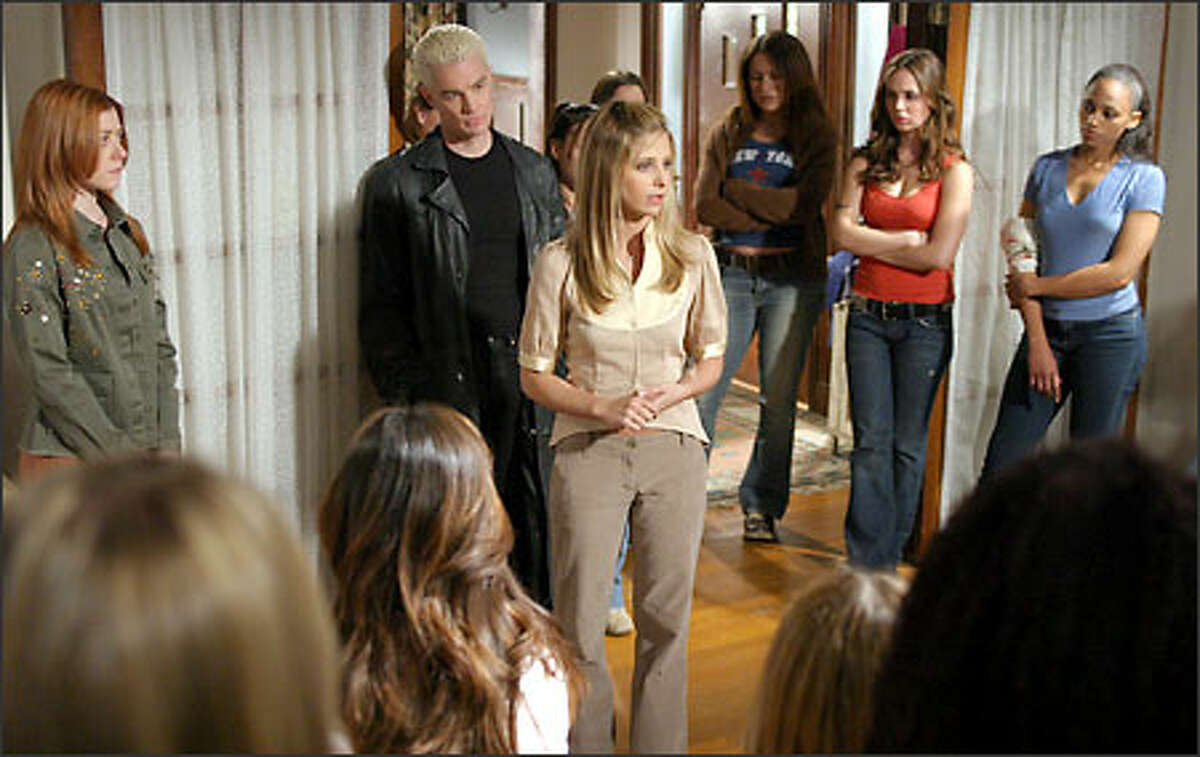 Buffy (Sarah Michelle Gellar, center) prepares her makeshift army -- including Willow (Alyson Hannigan, far left), Spike (James Marsters, center left) and Faith (Eliza Dushku, second from right -- for the titanic showdown.