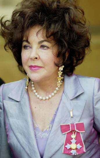 Actress Elizabeth Taylor after receiving the honour of Dame Commander of the Order of the British Em