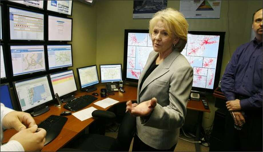 """U.S. Transportation Secretary Mary Peters tours INRIX Inc., a Kirkland traffic-data firm, on Friday. Peters called the """"Lexus lanes"""" label given to affluent drivers """"an urban myth that isn't exactly true."""" Photo: Gilbert W. Arias/Seattle Post-Intelligencer"""