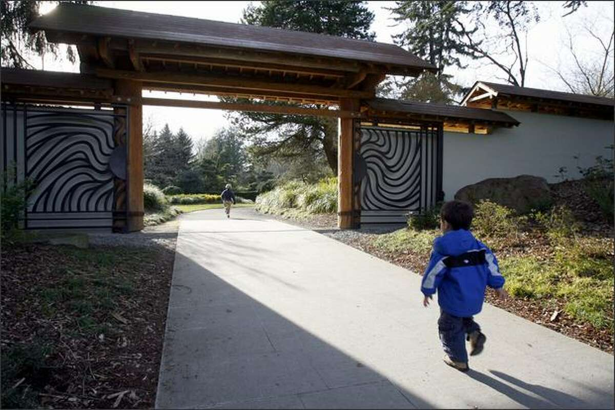 Young visitors race into the Kubota Gardens in Southeast Seattle, a little-known city park that was landscaped by a Japanese gardener beginning in the 1920s.