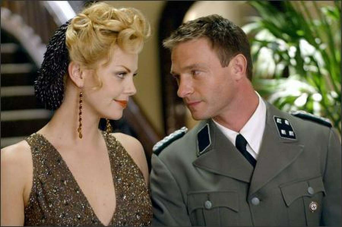 Thomas Kretschmann, right, plays a Nazi for at least the fourth time in his career, according to IMDB.com. In the film, he and Theron have an affair admist the flames of war.