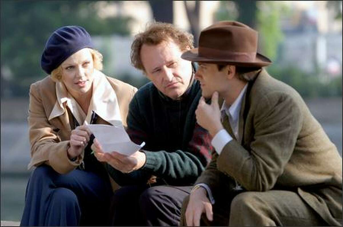 Theron and Townsend confer with director John Duigan, center. Duigan's