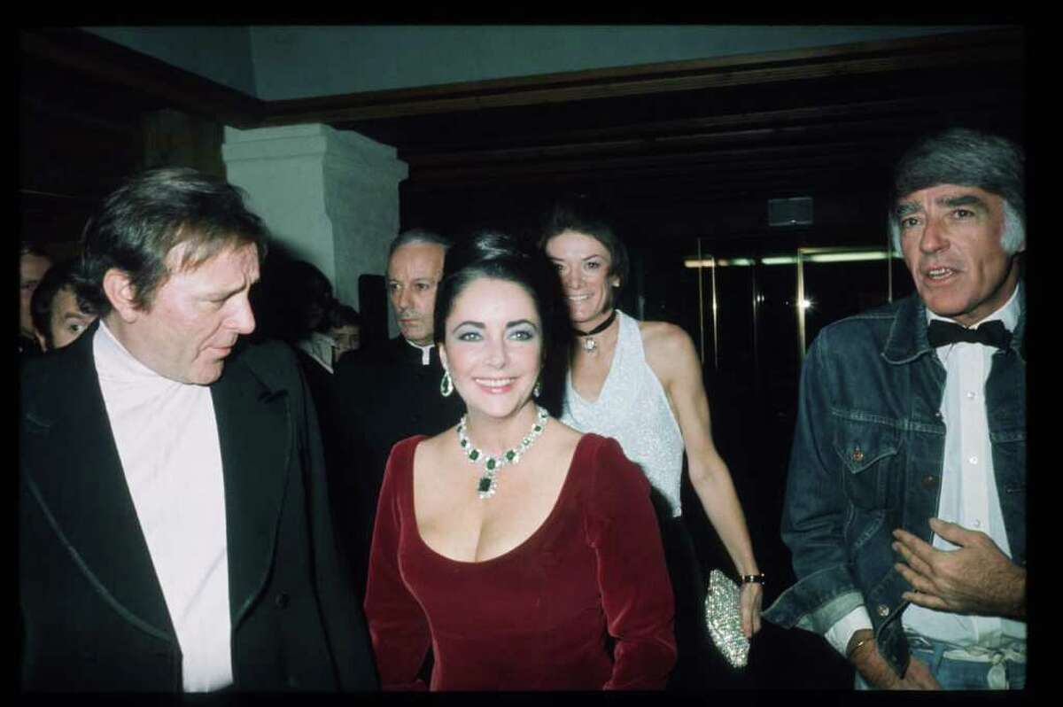 006911 01: Actors Richard Burton and Elizabeth Taylor stand next to each other February 1, 1974 in Switzerland. Oscar winner Taylor made several relatively obscure movies in Europe, including