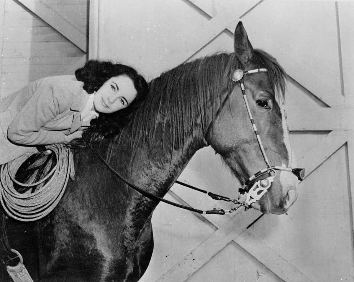 circa 1945: British born American actress, Elizabeth Taylor on horseback.