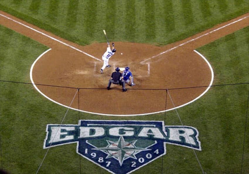 Mariners Edgar Martinez hits against the Texas Rangers during