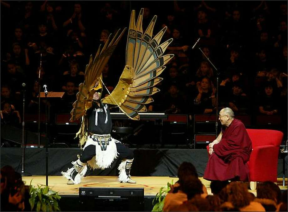 A Native American dancer performs for the Dalai Lama. Photo: Scott Eklund/Seattle Post-Intelligencer