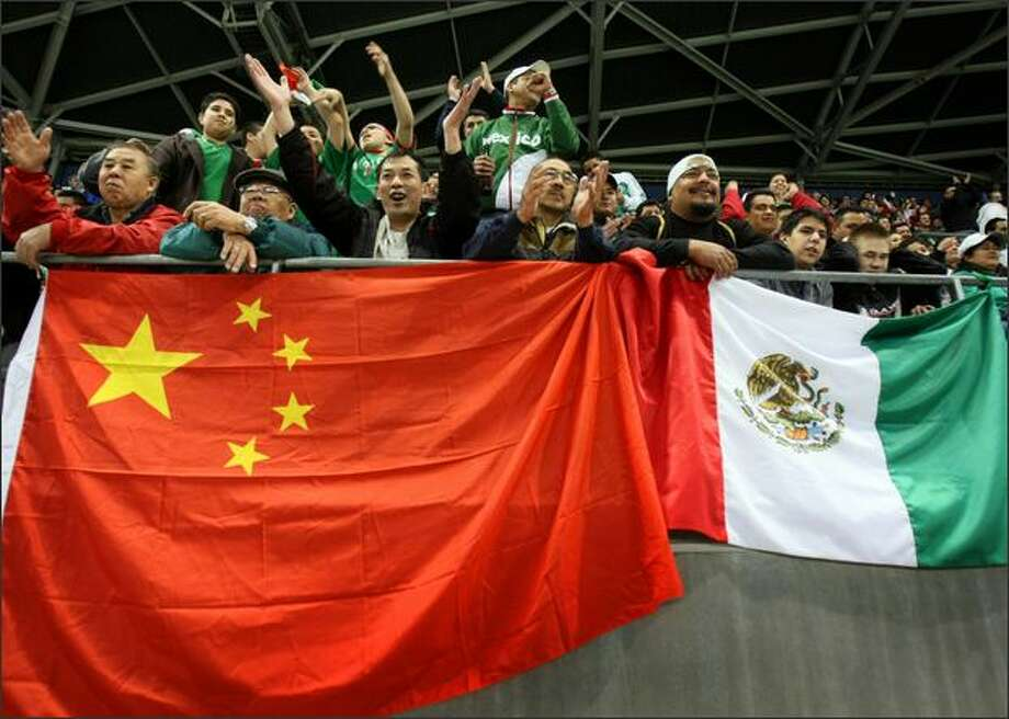 Fans of the Chinese and Mexican national teams root for their teams during a soccer match between Mexico and China at Qwest Field. Photo: Joshua Trujillo/Seattle Post-Intelligencer