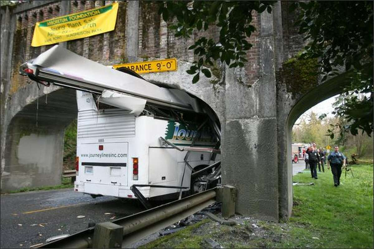 A view of the charter bus that hit a pedestrian bridge Wednesday in the Washington Park Arboretum.