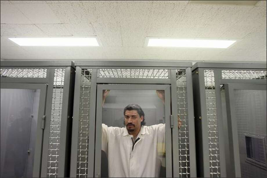 """Inmate Jose Fajardo, 27, stands in the Intensive Management Unit, also known as """"the hole,"""" at Clallam Bay Corrections Center. (Mike Kane / Seattle Post-Intelligencer) Photo: Mike Kane/Seattle Post-Intelligencer"""
