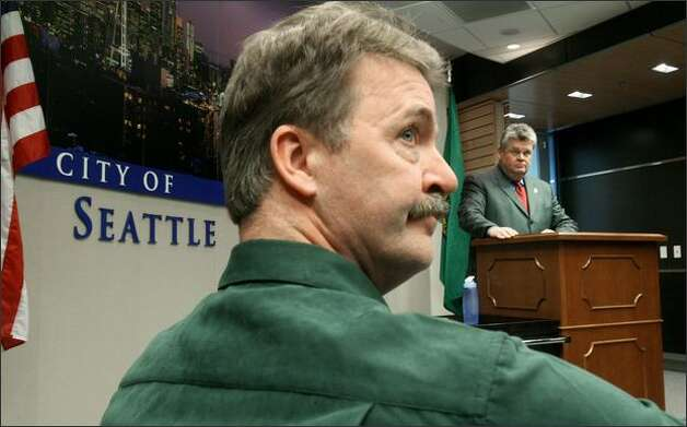 Steven Pyeatt, executive director of Save Our Sonics, and Seattle Mayor Greg Nickels listen to a reporter's question during a news conference that followed the NBA Board of Governors 28-2 vote to approve the Sonics ownership's request to relocate the team to Oklahoma City. Photo: Dan DeLong/Seattle Post-Intelligencer