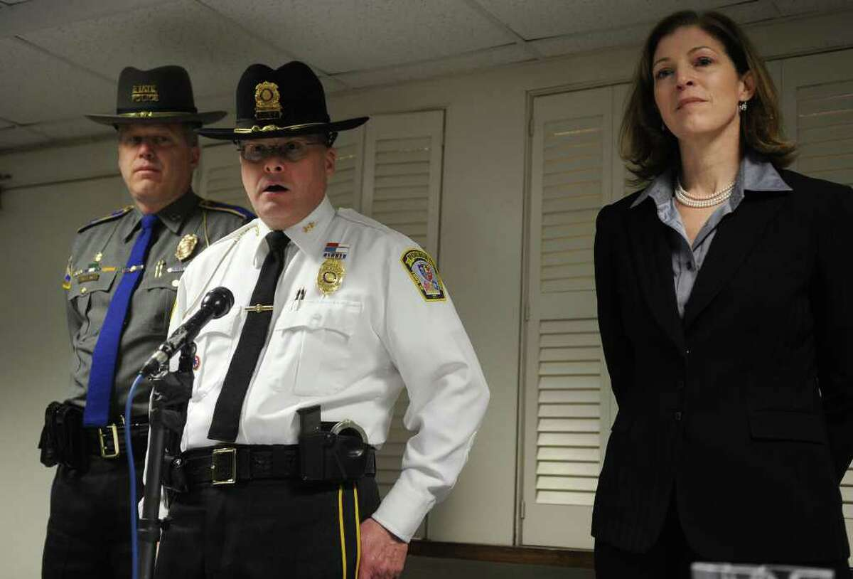 Orange Police Chief Robert Gagne, center, announces that13 year-old Isabella Oleschuk was found safe on Wednesday, March 23, 2011, To the right is FBI Special Agent in Charge Kimberly Mertz. The news was announced during a press conference at the Orange Congregational Church in Conn.