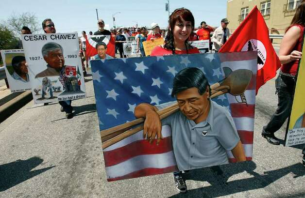Hannah Ortiz (right) carries a painting of Cesar Chavez which was made by her father, Abel, during the 14th annual Cesar E. Chavez March for Justice on Saturday, Mar. 27, 2010. The march started at Guadalupe Plaza and progressed toward Alamo Plaza. The march marked the anniversary of the civil rights activist and labor leader's efforts to bring attention to the issues of workers' rights in America. Kin Man Hui/kmhui@express-news.net Photo: KIN MAN HUI, SAN ANTONIO EXPRESS-NEWS / kmhui@express-news.net