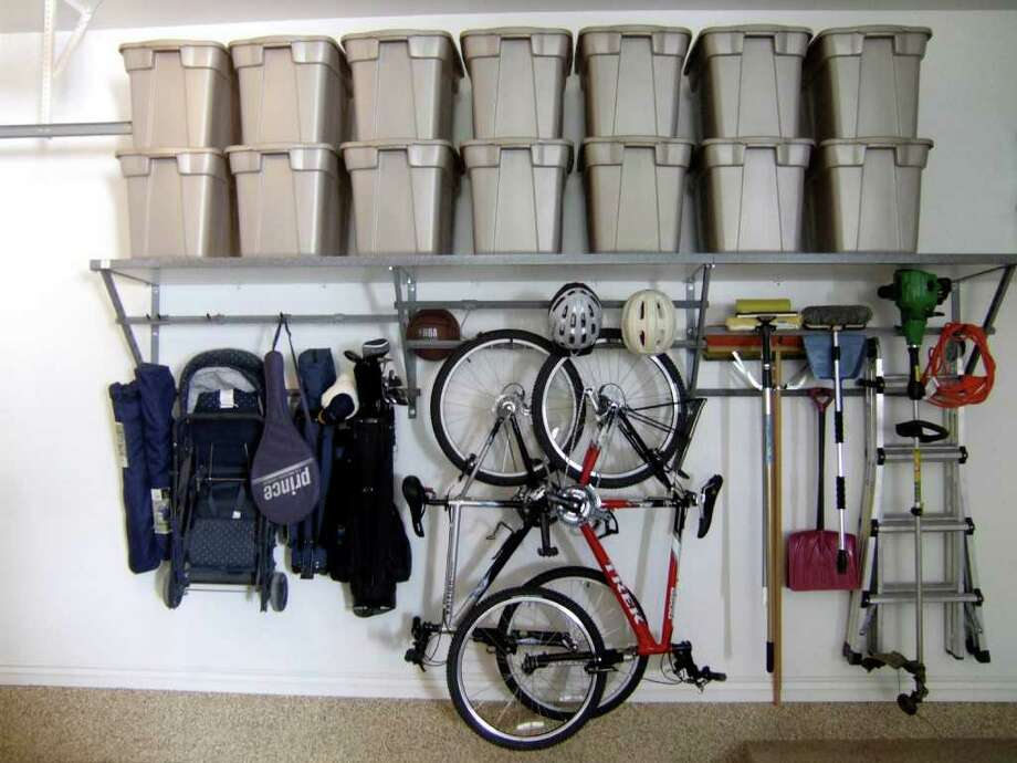 Get a jump start on spring cleaning, heck, you can throw open the garage and start there. Getting organized will leave you feeling accomplished for the day. Photo: AP