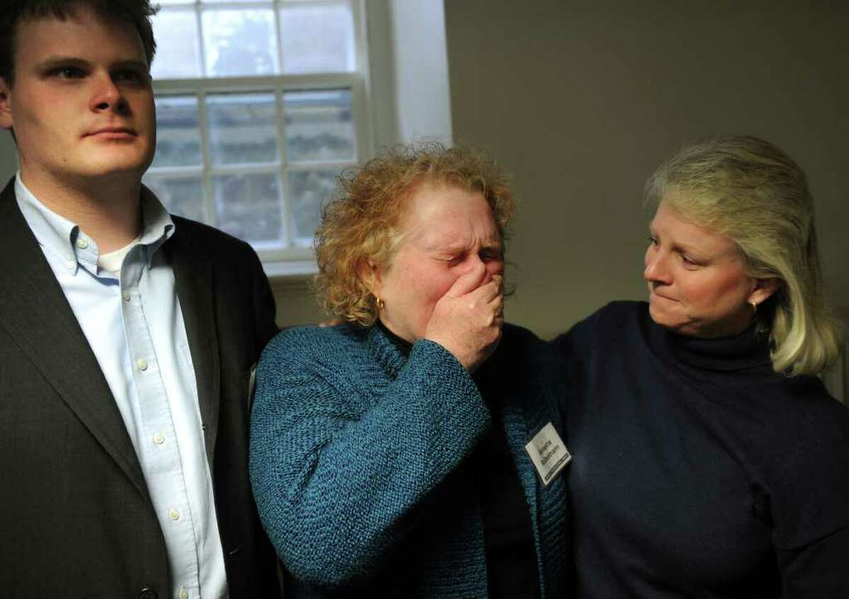Orange Congregational Church Deacon Annette Rubelmann, center, sobs with joy after hearing the announcement that the missing girl, Isabella Oleschuk, had been found unharmed. The news was announced at a press conference at the church on Wednesday, March 23, 2011. From left are church pastor's son Stuart King, Rubellmann, and church youth director Beth Rafferty.