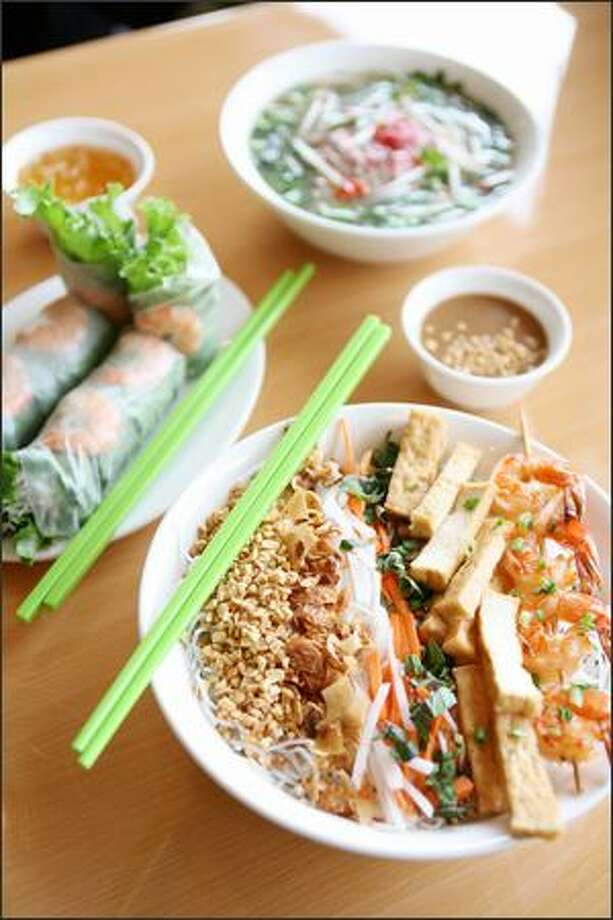 The menu at Time 4 Pho in Magnolia includes, clockwise from lower right: bun (noodle salad) with tofu and shrimp skewer, spring rolls and pho with steak. Photo: PAUL JOSEPH BROWN/P-I