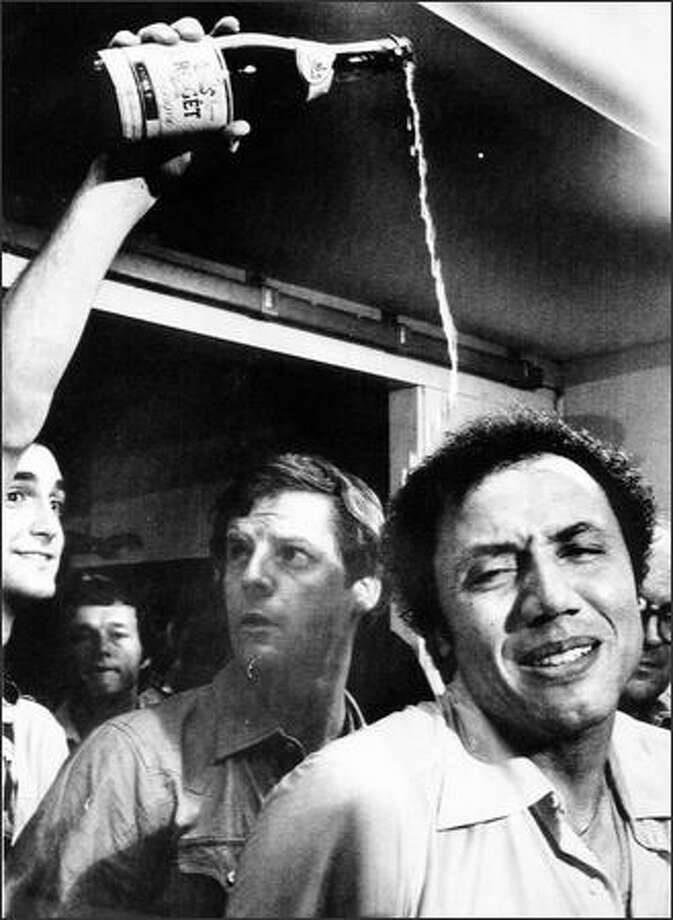 Supersonics head coach Lenny Wilkens tries to smile as champagne is poured over his head in the dressing room in Landover, Md., after the Sonics beat the Washington Bullets on June 1, 1979 ,for the NBA national championship. Photo: Seattlepi.com