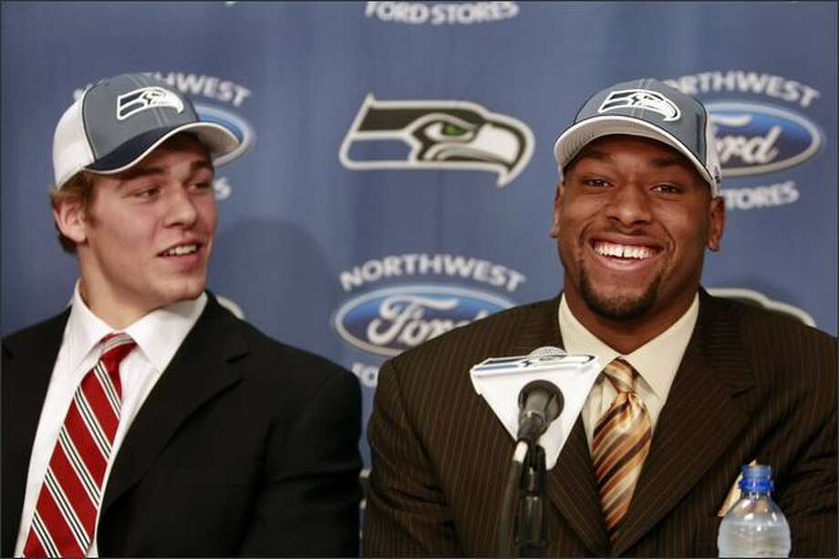 Former rivals, now Seahawks teammates, 2nd round draft pick TE John Carlson, of Notre Dame, left, and 1st round pick DE Lawrence Jackson, of USC, address the media at a press conference in Kirkland. Photo: MERYL SCHENKER/P-I