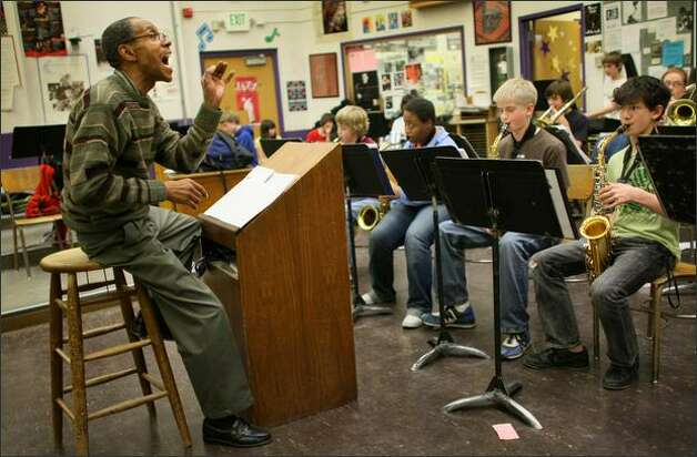 Washington Middle School jazz band teacher Robert Knatt, a 36-year veteran of Seattle schools, works with his students before they depart for the Reno Jazz Festival. Photo: Joshua Trujillo/Seattle Post-Intelligencer