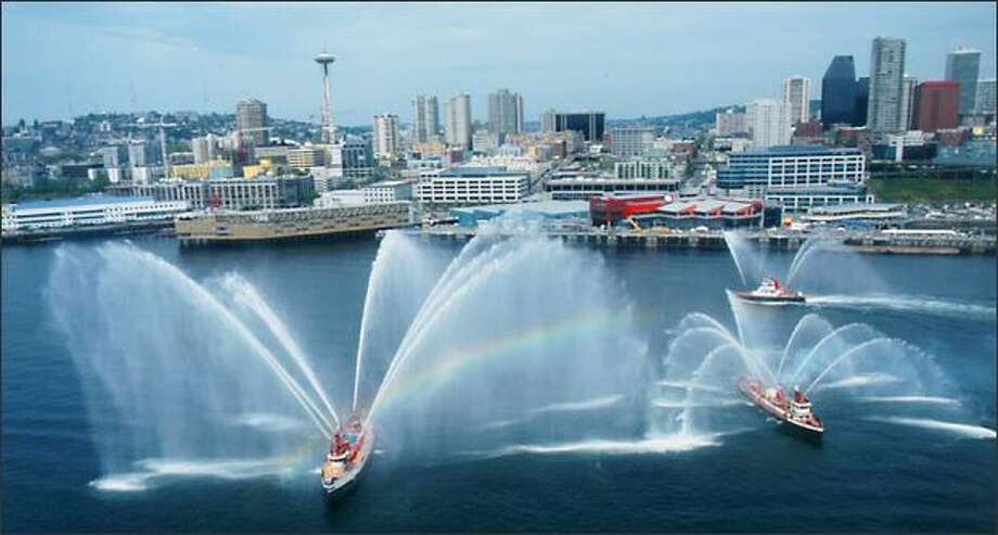 A fireboat display in Elliott Bay is part of the Maritime Festival, scheduled for May 10. Photo: /