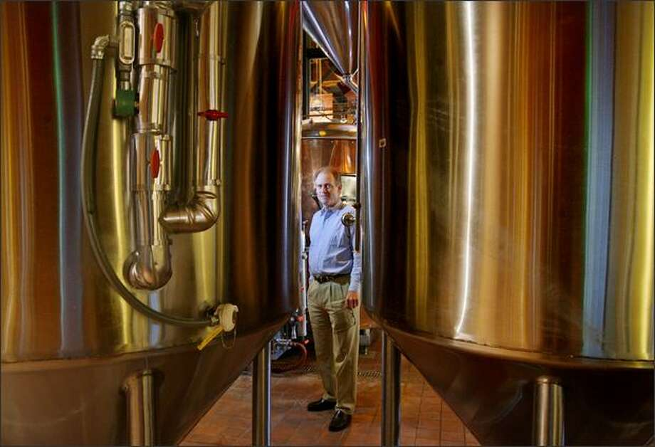 """Chief Executive Scott Barnum, in the brew house of the Pyramid Alehouse in Seattle, sees """"a minimal impact"""" on Pyramid's 500 or so employees. Photo: Dan DeLong/Seattle Post-Intelligencer"""