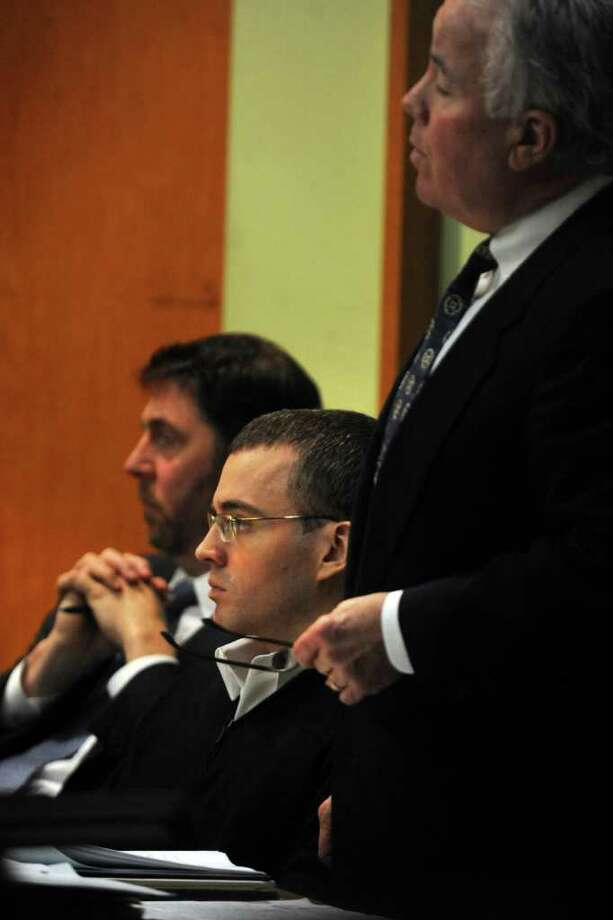 Christopher DiMeo in Superior Court in Bridgeport, Conn. March 23rd, 2011, during the penalty phase of his trial. DiMeo is seen here with defense attorneys Jeffrey Hutcoe (left) and Michael Courtney. He has been found guilty of two counts of murder and one count each of first-degree robbery and capital felony in the deaths of Tim and Kim Donnelly during the robbery of their Fairfield jewelry store in February of 2005. Photo: Ned Gerard / Connecticut Post