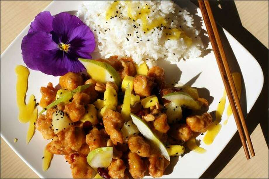 The mango cashew chicken entree at Mr. & Mrs. Wok in Crown Hill features breaded meat in a sweet sauce with mango slices, pineapples, cranberries and pears. Photo: Karen Ducey/Seattle Post-Intelligencer