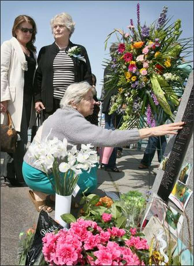 Lou Anne Rundall touches the name of her son, Davy Rundall, inscribed on a plaque, during memorial services Sunday at Fishermen's Terminal. Davy Rundall died in the Bering Sea in 2001. Photo: Paul Joseph Brown/Seattle Post-Intelligencer