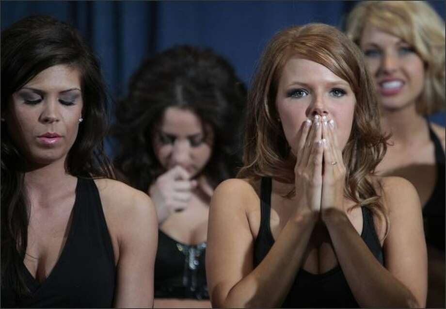 Tessa, right, was the last announced new Sea Gal selected Sunday at Qwest Field for the 2008 team. Twenty-eight women were chosen from a field of 65 by judges after two hours of dance trials. Photo: Meryl Schenker/Seattle Post-Intelligencer