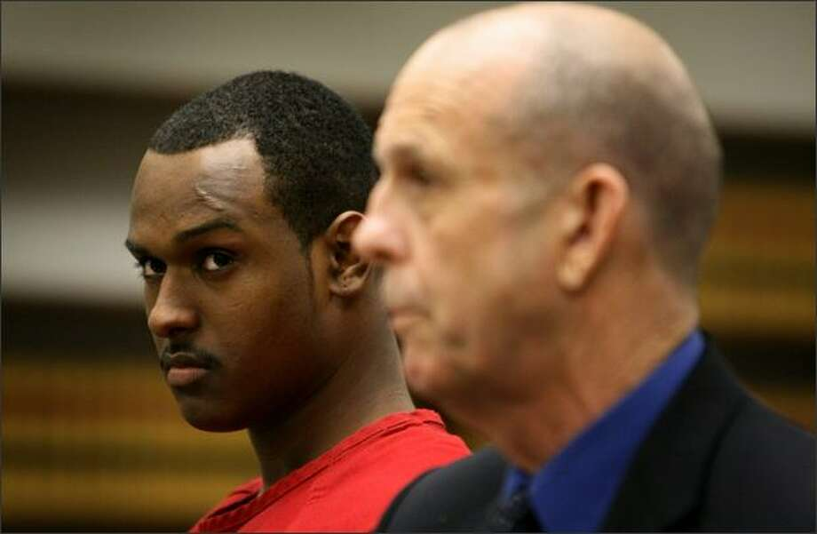 Samson Berhe, left, and attorney Byron Ward listen to Judge Dean Lum before a hearing that concluded the 20-year-old was insane when he killed Mike Robb in 2005. Photo: Joshua Trujillo/Seattle Post-Intelligencer