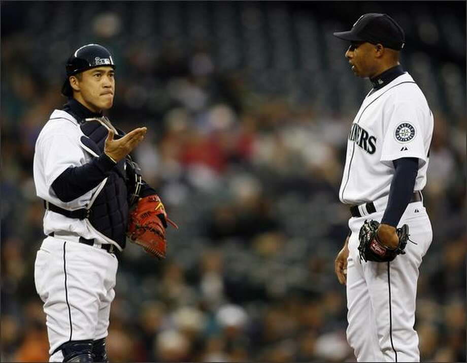 Mariners catcher Kenji Johjima looks a lttle frustrated with pitcher Miguel Batista just before Batista was pulled from the game in the third inning. Photo: Mike Urban/Seattle Post-Intelligencer