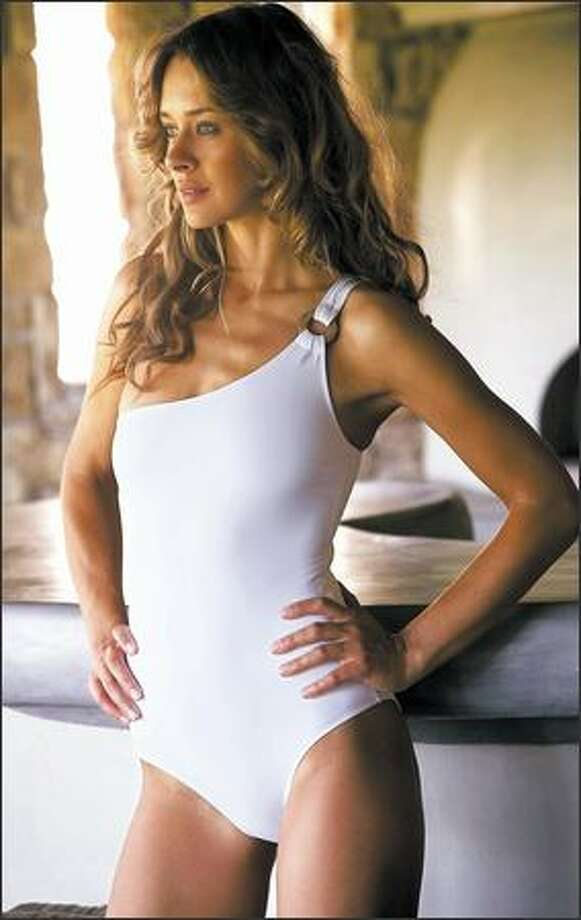 Oliver Pearce offers classic looks with a white one-piece bathing suit designed by Melissa Odabash.