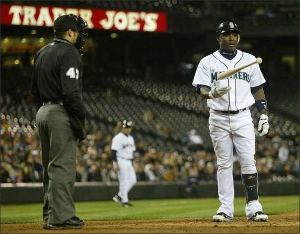 Mariners shortstop Yuniesky Betancourt is called out on strikes by home plate umpire Mark Wegner. Photo: Mike Urban/Seattle Post-Intelligencer