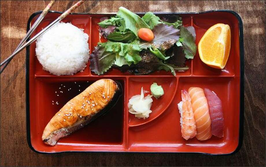 J-Sushi in the International District offers a deal for lunch: a bento box with salmon (or chicken) teriyaki and three pieces of nigiri sushi for $7.95. Photo: PAUL JOSEPH BROWN/P-I