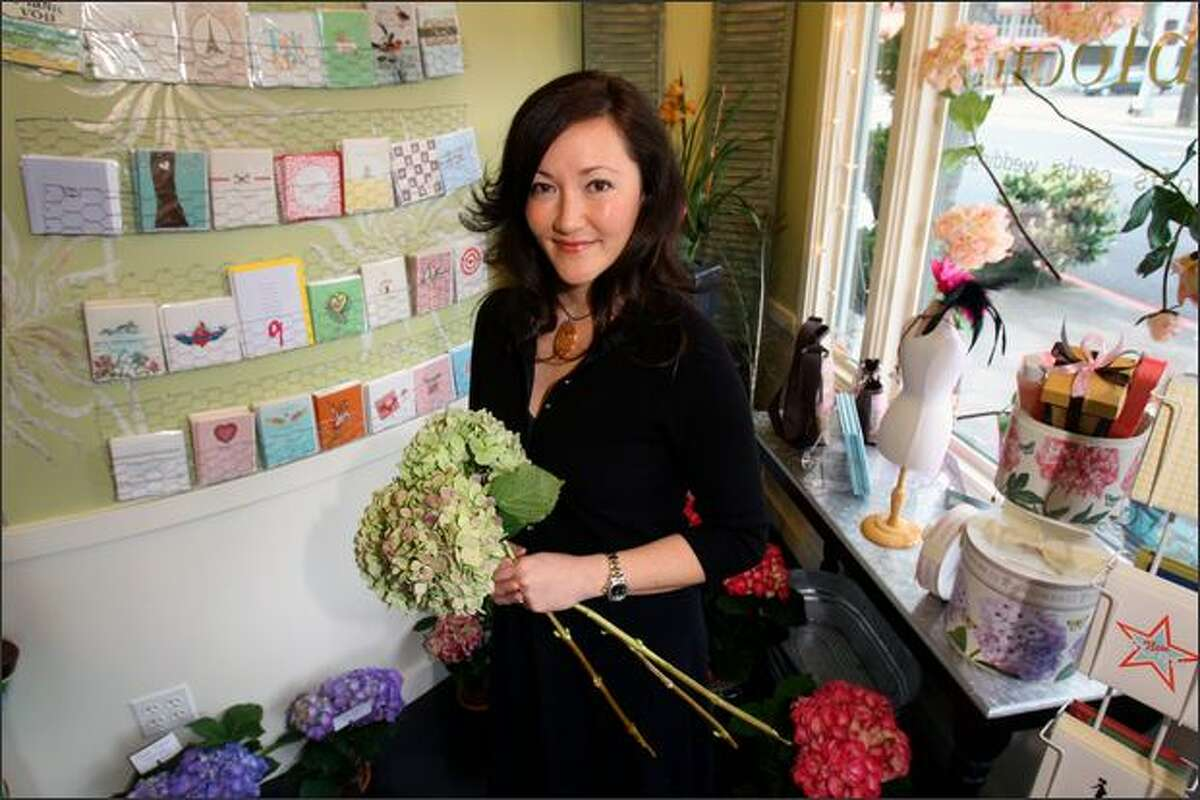 Floral designer Miya Ferguson, owner of Willow & Bloom in Fremont, creates bouquets of hydrangeas, mums or roses accented with leaves or even limes.