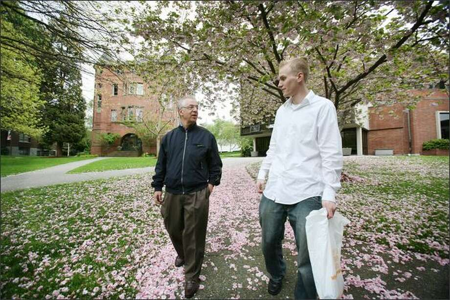 Steve Lake, left, a Las Vegas pit boss, has visited hundreds of college campuses. On Sunday he toured Seattle Pacific University with guide Stefan Bennett, a senior communications and business major. Photo: Paul Joseph Brown/Seattle Post-Intelligencer