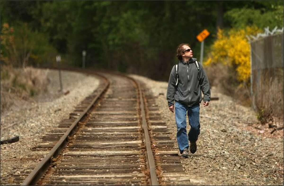 Robert Manzlak walks to work Monday from the South Kirkland park and ride along the Eastside rail corridor, which Manzlak has used for his work commute since 2003.