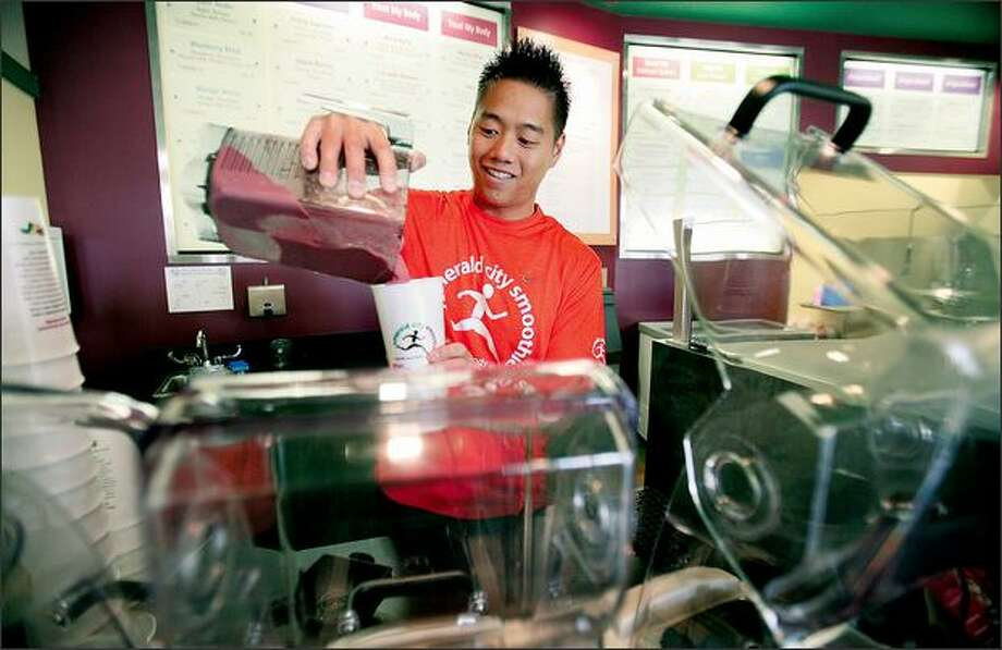 Michael Eng is the owner of the new Emerald City Smoothie in Ballard. The local chain is expanding nationally and faces competition from Starbucks. Photo: Paul Joseph Brown/Seattle Post-Intelligencer
