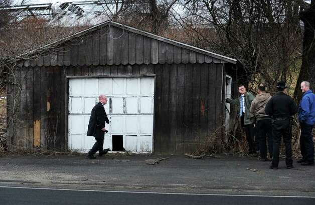 FBI agents investigate garage of an abandoned farm stand Indian River Road in Orange, Conn. where 13 year-old Isabella Oleschuk was found safe on Wednesday, March 23, 2011. Photo: Brian A. Pounds / Connecticut Post