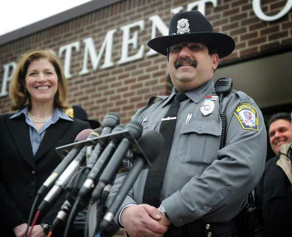 FBI Special Agent in Charge Kimberly Mertz, left, and Orange Police Officer Jude Fedorchuck smile as they comment on the safe return of missing girl Isabella Oleschuk on Wednesday, March 23, 2011. Acting on a tip, Fedorchuck discovered the girl staying in an abandoned garage on Indian River Road in Orange, about three miles from her home. Photo: Brian A. Pounds / Connecticut Post