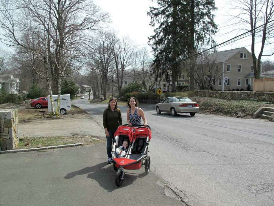 Alison Minter and Mary Flaherty on the side of a sidewalk-less Main Street. Photo: Contributed Photo;Paresh Jha Staff Photo, Contributed Photo / New Canaan News